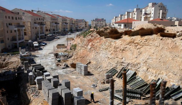 Construction site in the West Bank settlement of Modiin Illit: one mile outside the Green Line. Photo by AP