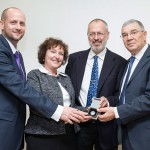 From left: Aviv Katz CEO, Israel Coins and Medals Corp., presents with Dr. Karnit Flug, Governor of the Bank of Israel, the official Israel Yad Vashem 60-year anniversary coin